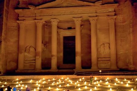 al: Al Khazneh or The Treasury building at Petra at night, Jordan Stock Photo