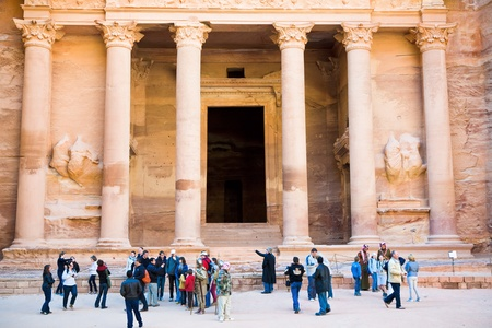 PETRA - JORDAN, FEBRUARY,21: tourists near gate of Treasury Monument in antique city on 21 February, 2012 in Petra, Jordan. Petra was rediscovered for the western world by Swiss explorer Johann Ludwig Burckhardt in 1812