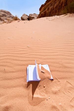 office notebook in red sand of Wadi Rum dessert in Jordan Stock Photo