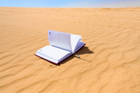 notebook in sand dune of Wadi Rum dessert, Jordan photo