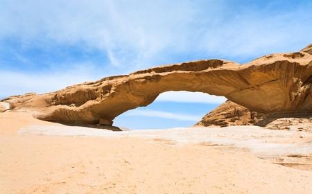 sandstone Bridge rock in Wadi Rum dessert, Jordan photo