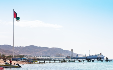 AQABA - JORDAN, FEBRUARY,23: Urban beach and port on February 23, 2012 in Aqaba. Jordan country has only one exit to Red sea and only one sea port.