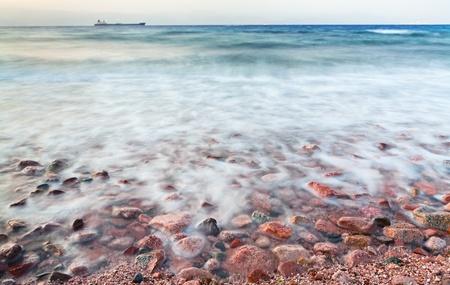 cobble stone beach of Read Sea on sunset, Jordan Stock Photo - 13369652