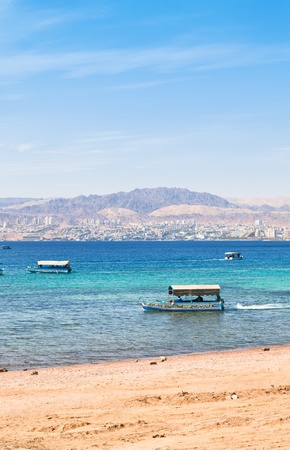 Aqaba gulf and view on Israel town Eilat from Jordan photo