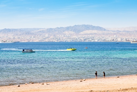 municipal Aqaba beach and view on Eilat town from Jordan photo