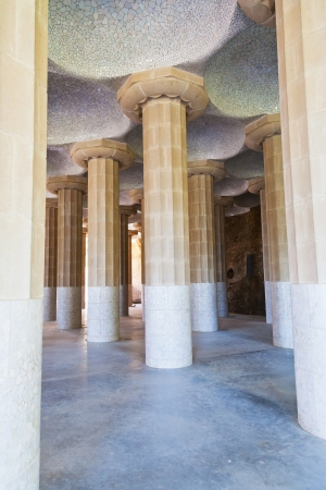 BARCELONA, SPAIN - APRIL,26: column hall of Parc Guell. on April 26, 2012 in Barcelona. It was designed by the Catalan architect Antoni Gaudi and built in the years 1900 to 1914