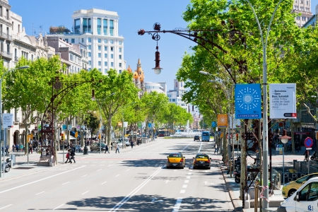 BARCELONA - APRIL,26: Passeig de Gracia - one from major avenues on April 26, 2012 in Barcelona. The avenue was made according with first urbanisation project in 1821 and was 42 metres wide in 1827. Stock Photo - 13626958