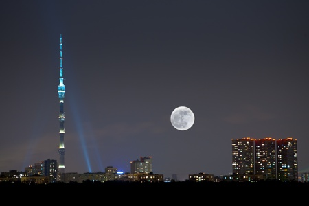 full moon under city, Ostankino television tower, Moscow Stock Photo - 13596016