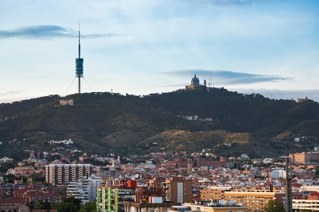 Tibidabo Mountain with TV tower and Expiatory Church in Barcelona in evening photo