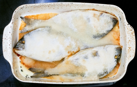 three dourada fish baked in salt photo