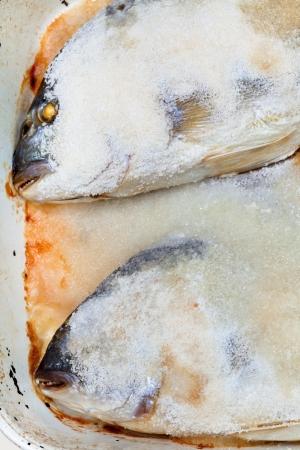 two dorada fish baked in salt photo