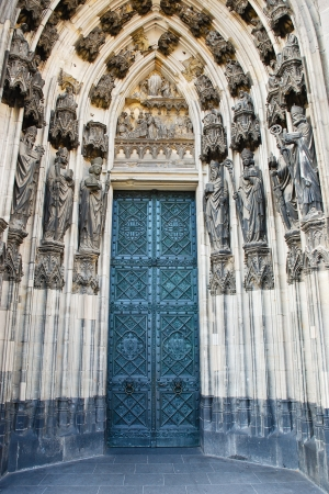 main gate: big door of cathedral in Cologne in Germany