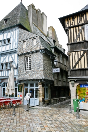 dinan: old urban street in Dinan town in rainy day, France Stock Photo