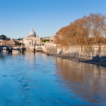 autumn view on Tiber river and St Peter Basilica in Rome photo