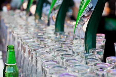 porter house: green bottle and glasses for beer