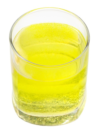 carbonated: glass of yellow carbonated water with vitamin C isolated on white background