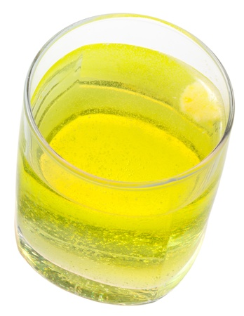 glass of yellow carbonated water with vitamin C isolated on white background Stock Photo - 15069160