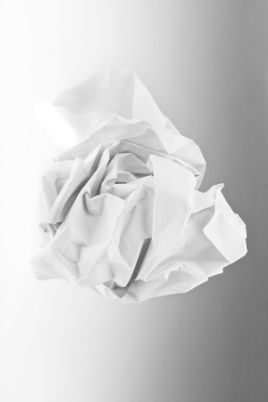 wad of paper on grey background photo