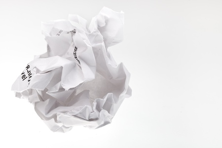 crumpled sheet of paper on grey background photo