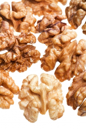 few peeled walnut kernels isolated on white background close up Stock Photo - 15317454