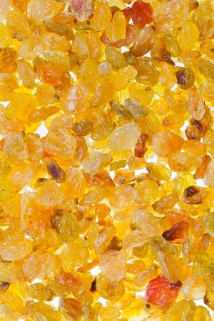 sultana: many sultana raisins close up on white background