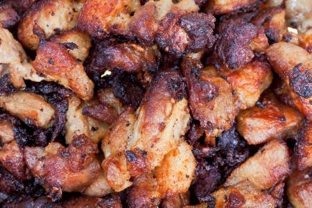 pan fried: padella piatto di maiale fritto close up
