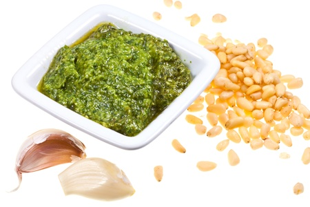 bulbet: italian pesto sauce with pine nuts and garlic cloves isolated on white background