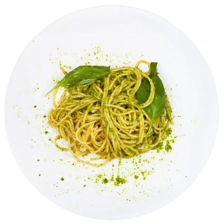 top view spaghetti mixed with pesto on plate isolated on white background photo