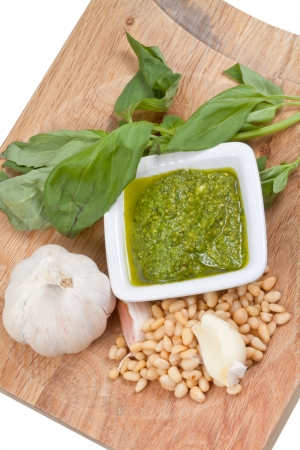 bulbet: italian pesto sauce with ingredient on wooden board isolated on white background
