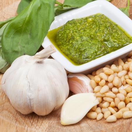 bulbet: italian fresh pesto sauce with ingredient on wood board