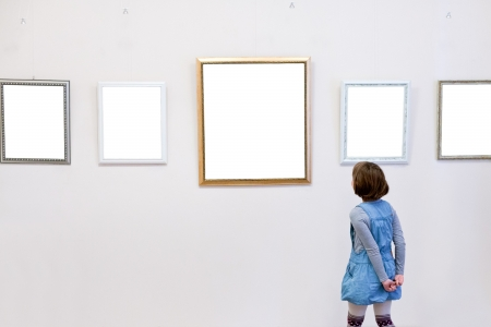 girl sees a picture frames in art gallery photo