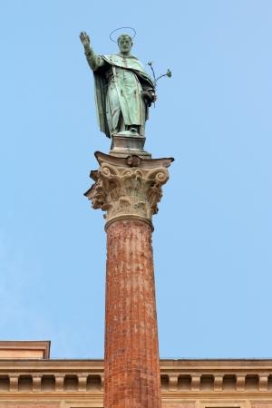 catholicity: statue and column of Saint Dominic near Basilica of San Domenico, Bologna, Italy Stock Photo