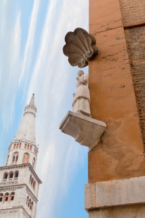 way of st  james: The Bonissima is medieval statue on the corner of the Town Hall and Torre della Ghirlandina in Modena, Italy Stock Photo
