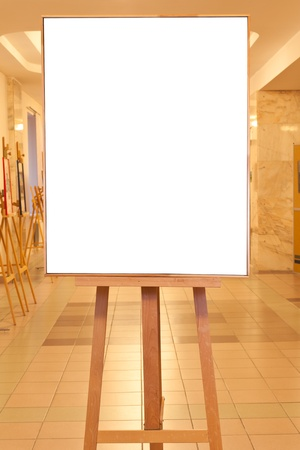 big picture frame with white cut out canvas on easel with yellow light gallery background Stock Photo - 16862694