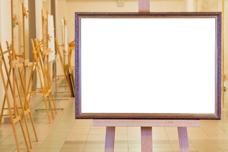 big picture frame with white cut out canvas on easel in gallery hall photo