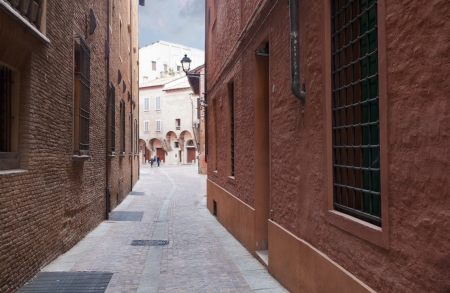 side street in medieval town of Bologna before rain, Italy photo