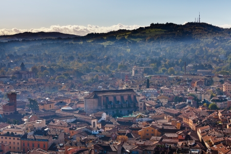 bird eye view from Asinelli Tower on Bologna with mountain, Italy photo
