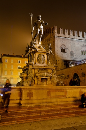 Fountain of Neptune in Bologna at night, Italy photo