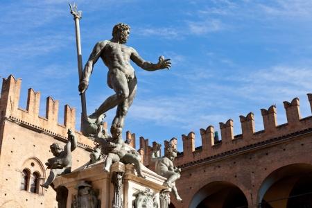 Statue of Neptune on Piazza del Nettuno in Bologna in sunny day, Italy