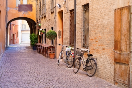old small stone medieval street in historical center of Ferrara, Italy photo