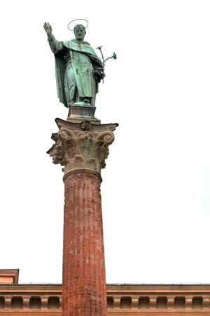 catholicity: statue and column of Saint Dominic near Basilica of San Domenico, Bologna, Italy on white background Stock Photo
