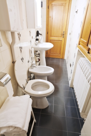 lavabo: modern interior of narrow lavatory room Editorial