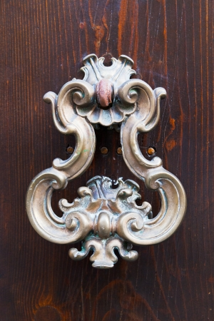 old bronze door handle on brown wooden urban door Stock Photo - 17096261