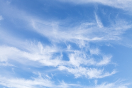 several swirling small white clouds in italian blue sky in autumn