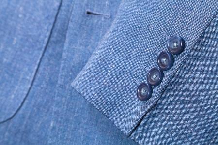 backstitch: sartorial background - fragment of blue silk mens suit close up