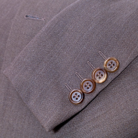 backstitch: sartorial background - fragment of wool mens suit close up