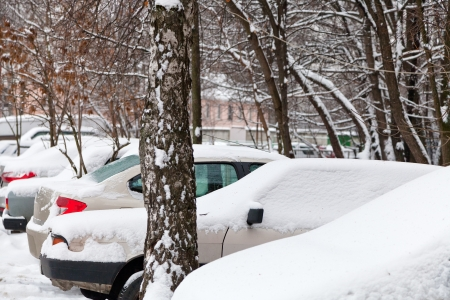 cars covered with snow on parking in Moscow, Russia Stock Photo - 17096420