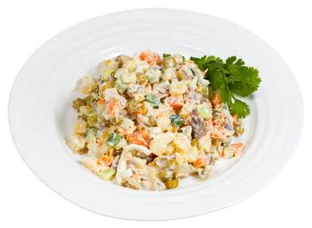 moscovian: Russian Olivier salad on plate isolated on white background