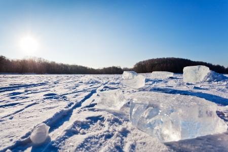frozen winter landscape with ice blocks photo