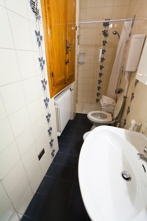 interior of narrow toilet room photo